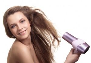 A woman drying her long beautiful hair